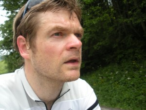 Another peddler joins the three men on a bike team